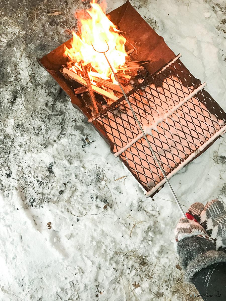 Lagerfeuer bei Schlittenfahrt